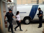 Lulu Martinez is handcuffed and led into a van by U.S. Customs and Border Protection agents. Martinez is a Dreamer and was taken into custody after trying to cross into the United States through the Morley port of entry in Nogales, Mexico. Photo by Perla Trevizo/Arizona Daily Star.
