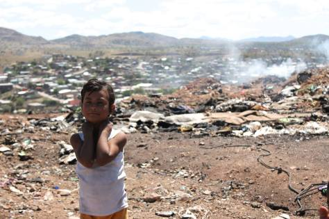Five-year-old Daniela Sandoval plays in el Tirabichi, an open dump in Nogales, Sonora, where her mother scavenges.